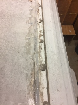 "This was the roof of a 12 year old RV that the seller claimed was stored under shelter and in pristine condition.  As you can see the rubber roof is in terrible shape with the black under-layer showing in the front, cracked skylight, missing plumbing vent-cap, rubber separation around rear roof vent, and a terrible home DIY silicone seal job on the front seam.  All the silicone did was seal in moisture.  The front 6-8"" of the RV roof was completely gone, full of ants and roaches.  Strangely enough, the front bedroom and bathroom looked really good, very few signs of water.  See picture below."